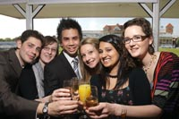 Students raising a glass