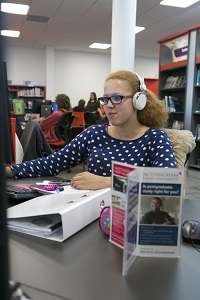 Brackenhurst Library, female student on fixed PC