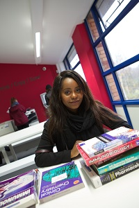 Clifton library Level 1 Female student using books