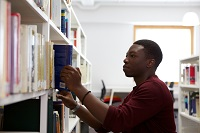 Boots Library - Male student selecting book