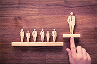 Wooden figures shaped like business people