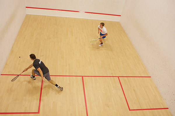 Two people playing a game of Squash