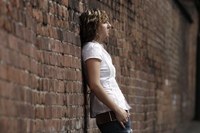 A student leaning against a wall