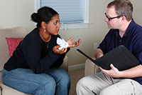 Counsellor offering support to person