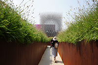 Woman approaching The Hive at the UK Pavilion, Milan 2015