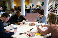 Students working together at a circular table