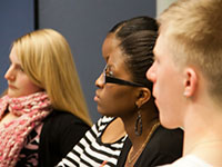 Close up of three students listening in a workshop or seminar