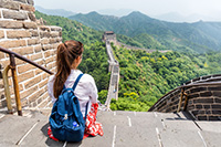 Student sitting on wall of China