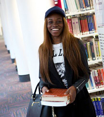 Female student holding books in Boots Library