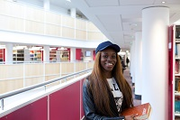 Boots Library, Level 2 female student amongst book shelves