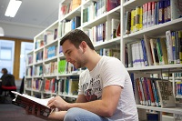 Boots Library, Level 1, Male student amongst shelves