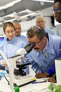 Professor Robert Winston looking through a microscope